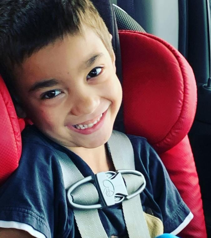 Child on way to speech therapy in car seat