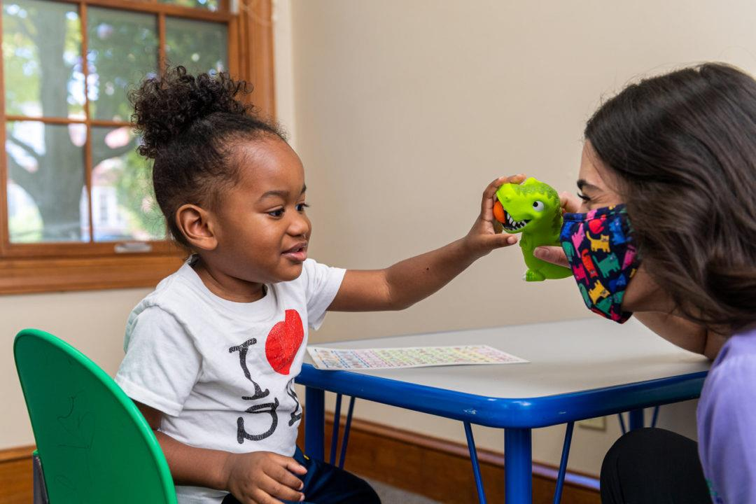 therapist and child playing games during therapy session at table