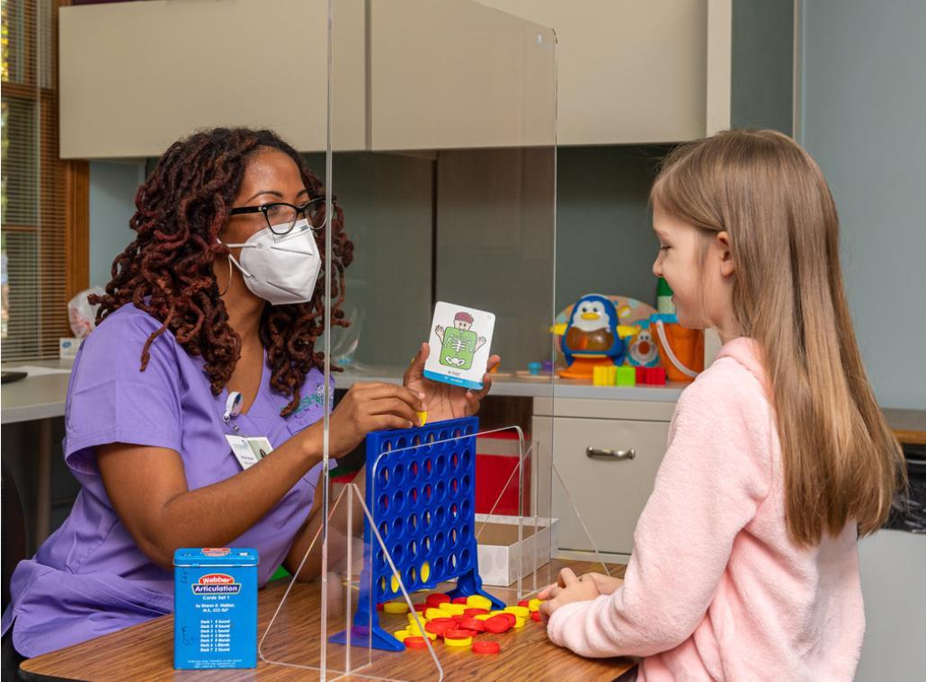 plastic barrier between therapist and patient