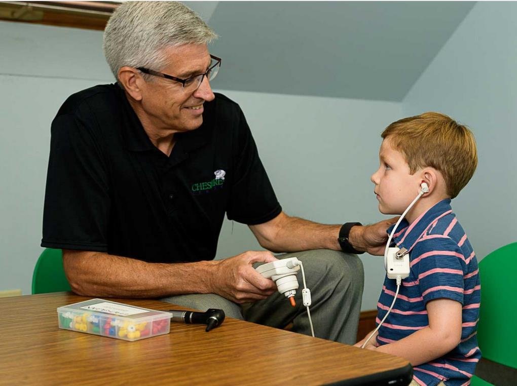 child patient getting hearing checked