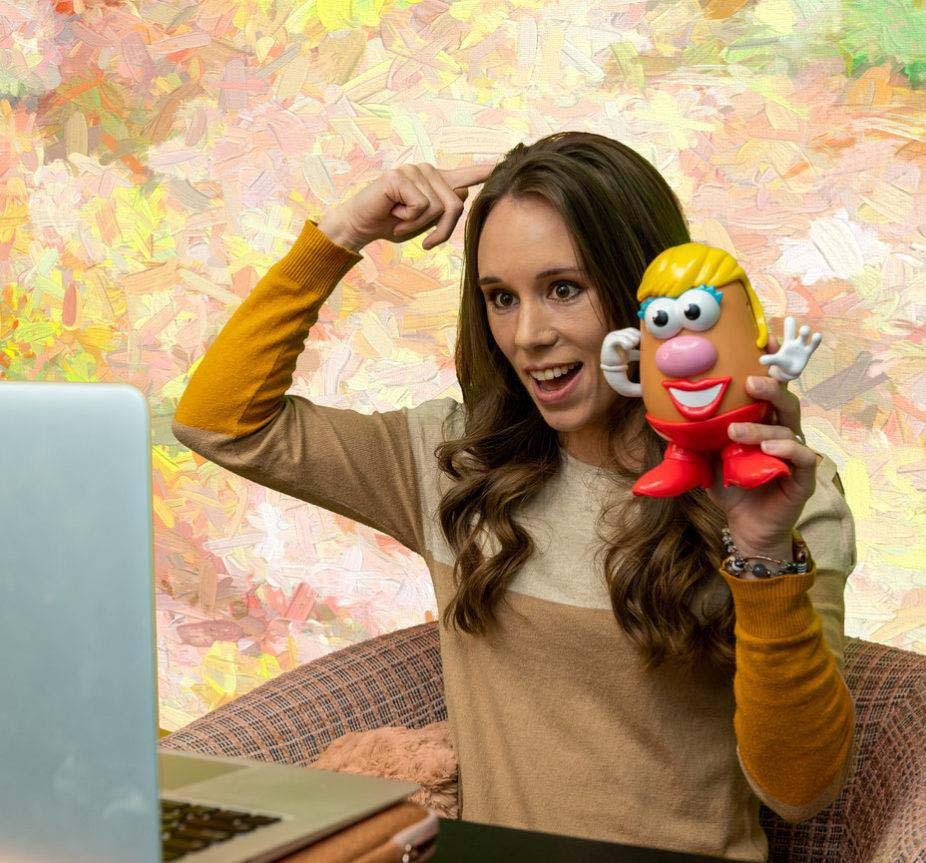 speech therapist giving online session with mr potato head doll