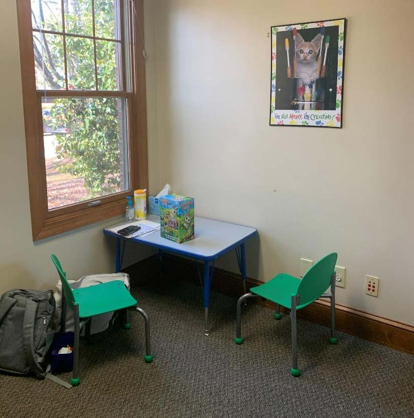 child-size table and chairs in speech therapy room